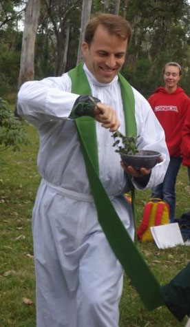 Fr. Tim executes the Sprinkling Rite with gusto and excitement.