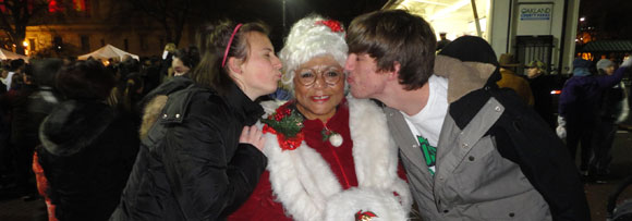 Christine and D.J. with Mrs. Claus at a holiday festivity.