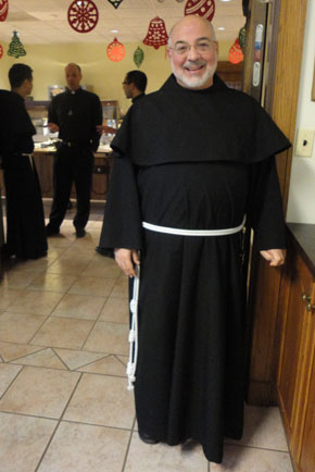 Good Brother Augustine who is the tailor for the Conventual Friars. Note the other priests chatting in the background.