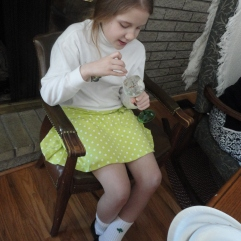 My youngest cousin, Clara, noms some ice cream.