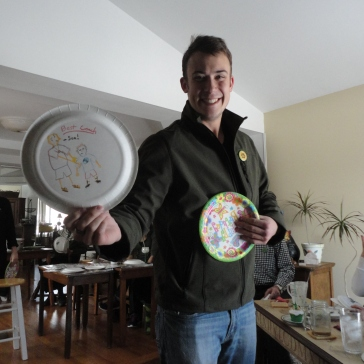 New thing for the year: making paper plate awards for birthday people. Here my Josh shows the one he made for our dad.