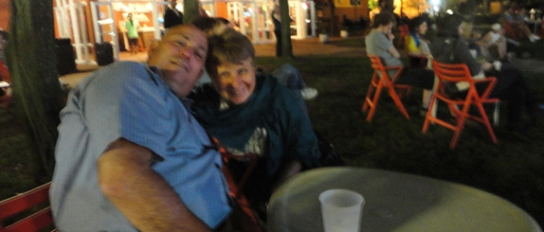 Fuzzy photo of the parentals at a concert.