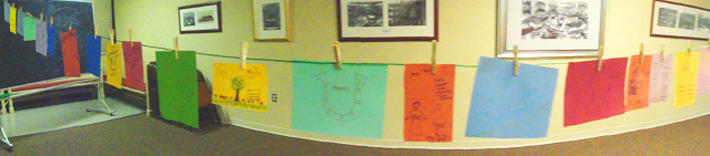 I had all of the people (ADULTS! ADULT PEOPLE! I had adult people play with colored paper and markers because it's what I do) draw a picture of someone who influenced their faith. Or they could draw something that reminded them of that person, too. And we made these makeshift flags of color and faith and memories and love.