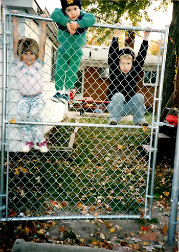 Just hangin' around on a fence. Christine, Josh, and Paul. Picture says this was in '94, Uncle Rico.