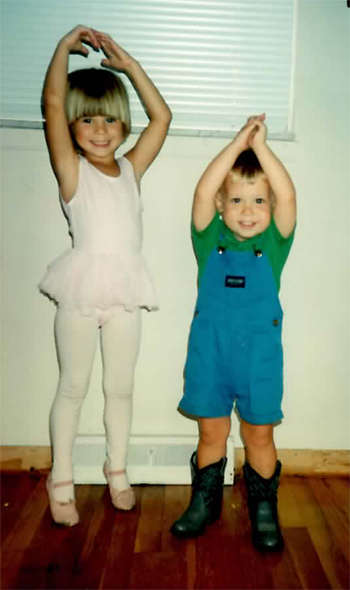 """Christine and leetle Josh in his baby cowboy boots reenact the dream sequence from """"Oklahoma."""" Cough. Or something."""