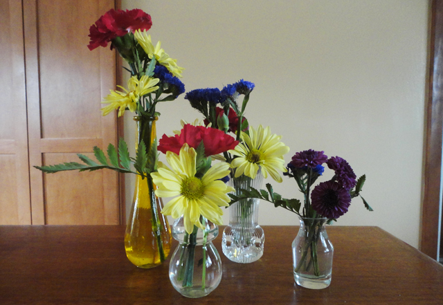 Bud vases of flowers, my favzies.