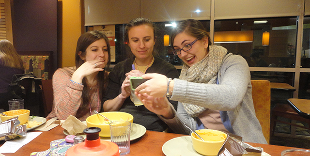Nicolette and Christine and Brigid...laughing over a photo at a Panera on our commute home.