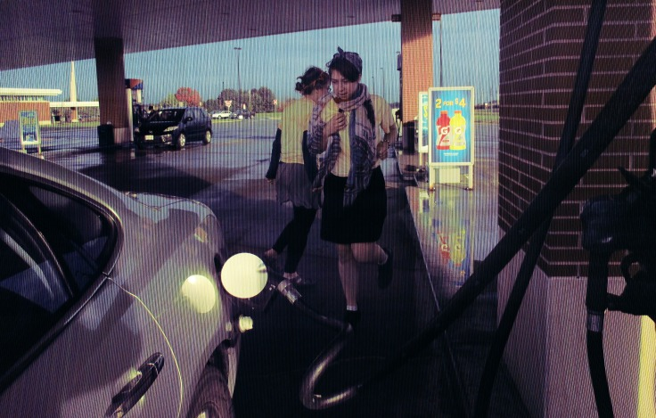 (This is Juli-YEAH doing a stretch-the-legs dance at a gas station).